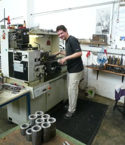 Rainer at a lathe working on some the larger parts of the T4