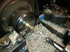 Parts for the T8 being produced on a revolver lathe