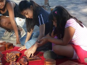 Kids play with puzzles made by Yavuz at his stall in the public square in the Mexican city of Juchitán de Zaragoza